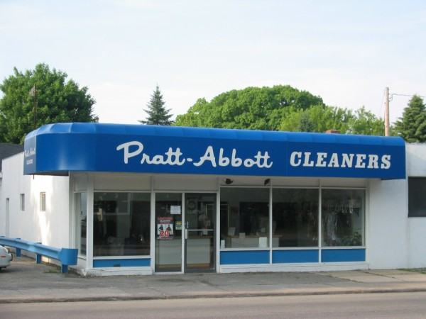 Custom stationary awning graphics for Pratt-Abbott cleaners, by Leavitt & Parris
