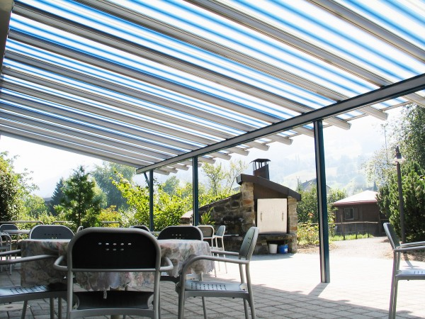 Blue and white striped retractable awning