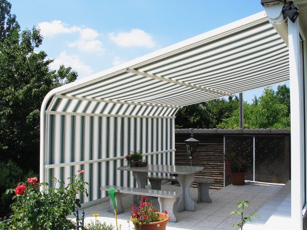 Custom striped retractable awning from Leavitt & Parris