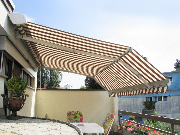 Custom brown and white striped retractable awning for patio from Leavitt & Parris