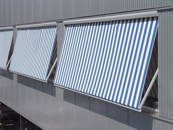 Blue and white striped retractable awning from Leavitt & Parris