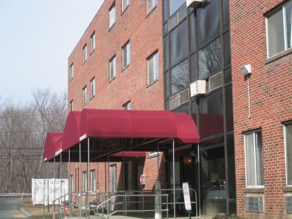 Custom stationary awnings for business, by Leavitt & Parris