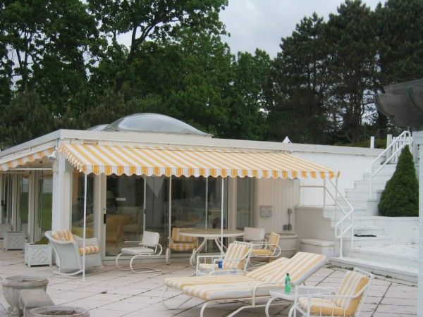 Custom yellow and white striped stationary awning by Leavitt & Parris