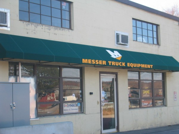 Stationary awning by Leavitt & Parris for Messer Truck Equipment entrance