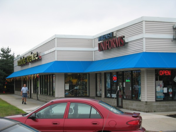 Blue stationary awning for business use by Leavitt & Parris