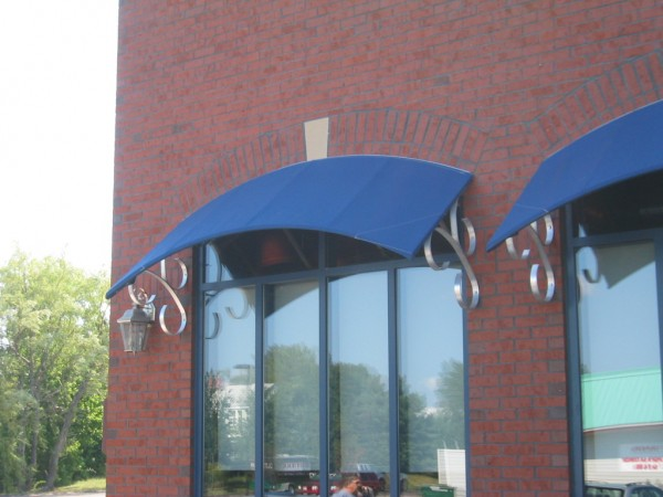 closeup of blue stationary awnings by Leavitt & Parris