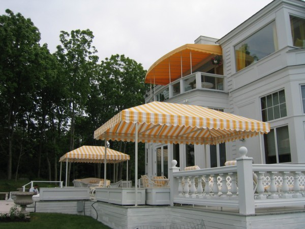 Custom yellow and white striped canopies for a home, from Leavitt & Parris