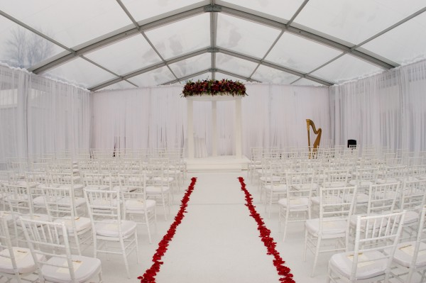 The ceremony tent was one of three large structures which housed the ceremony, cocktail hour, and reception at this Leavitt & Parris produced wedding event that took place on a farm