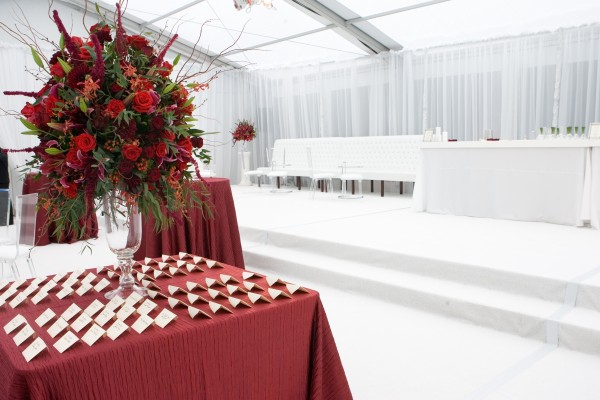 White and red provide a dramatic color scheme for a Maine October wedding