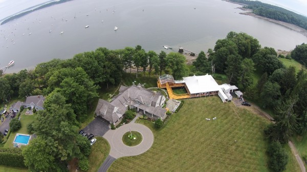 Aerial view of tent and structure set up for a Falmouth Foreside, Maine wedding by the ocean