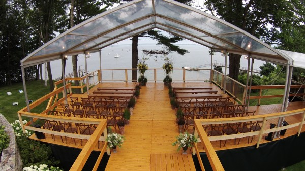 Ceremony tent structure, including flooring, set up by the ocean, for a Falmouth Foreside, Maine wedding