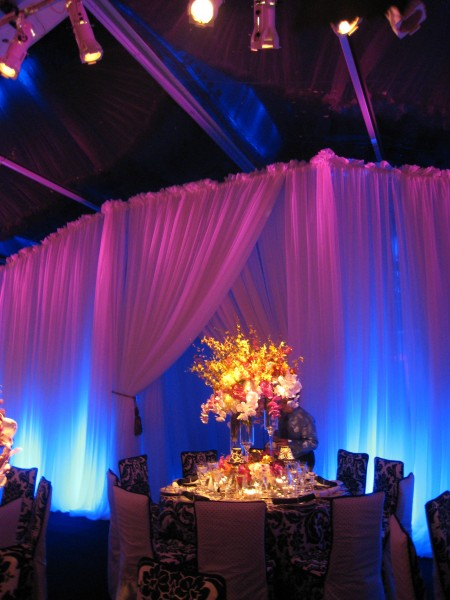 dramatic party event space in Brookline, with table arrangement, draping and flowers