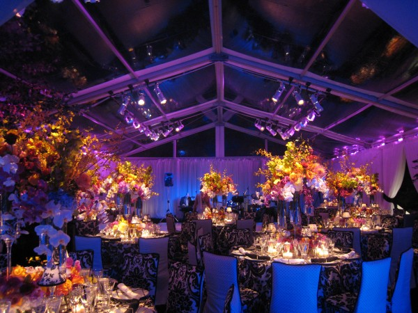 Dramatic party reception space showing flowers, with clear top structure at night, from Leavitt & Parris