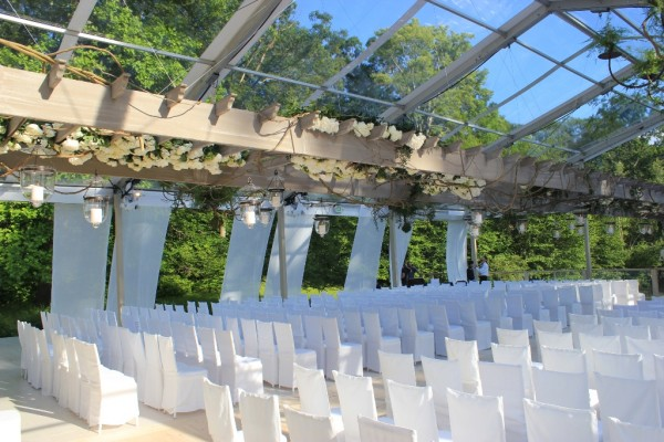18m Clear Top Structure for a wedding with custom wide plank pickled pine flooring and clear acrylic railings