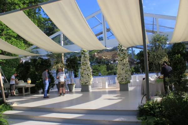 For a Greenwich, CT wedding, clear top wedding structure with custom flooring, from Leavitt & Parris