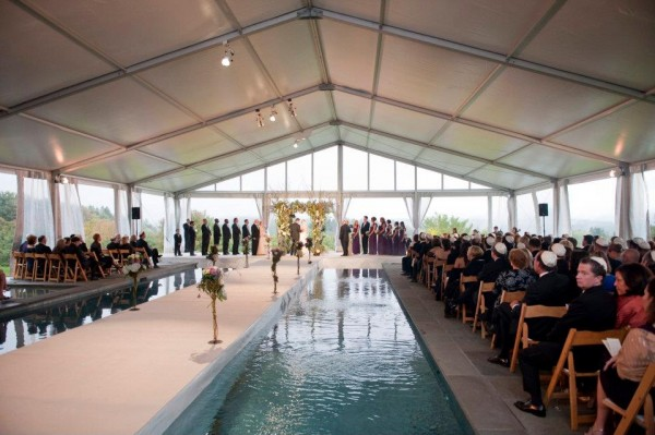 Leavitt and Parris produces wedding in Berkshires with tent and aisle built over pool