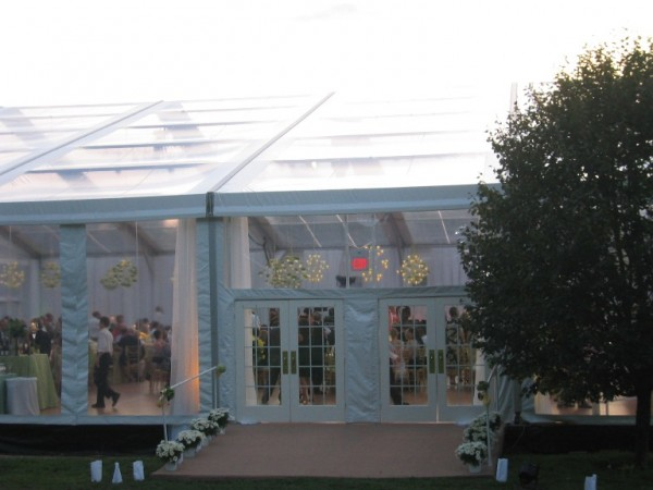 Side view of clear top tent structure from Leavitt & Parris for summer wedding on golf course