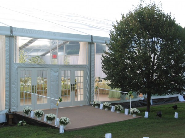 Tent structure entrance and decor from Leavitt & Parris, for a golf course wedding